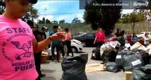 Jóvenes se unen para entregar víveres, no confían en gobiernos