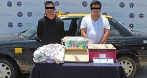 Detienen a 2 por robo a repartidor de cosméticos en Loma Bella