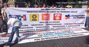 En manifestación, exburocratas promueven el voto en contra de Martha Erika