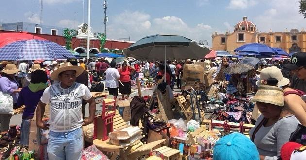 Se olvidan del efectivo en Cholula para conservar la tradición del trueque