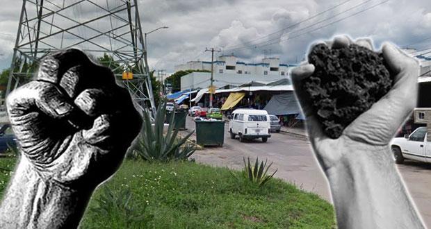 Riña entre Antorcha y Focem por disputa de lugares en Amalucan