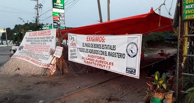 Michoacán y SEP acuerdan apoyo a CNTE si liberan vías férreas