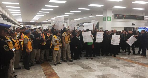 Tras protesta, empleados del NAIM acuerdan bono y pago retroactivo