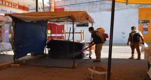 Fumigan mercado de Ixcaquixtla contra plagas y enfermedades