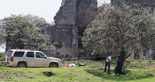 Hallan en San Miguel Espejo tres cuerpos con el tiro de gracia