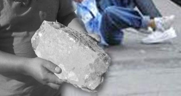 Con una roca, presunta pandilla mata a joven en San Miguel Canoa