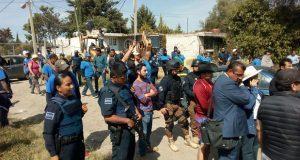 Antorcha y policías chocan por operativo de desalojo en Totimehuacán