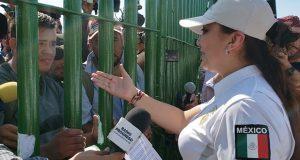 México niega entrada a caravana migrante; cientos lo intentan por río