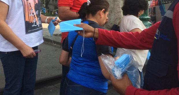 Pese a no prevenir contagios, Comuna dará cubrebocas a empleados
